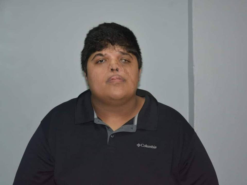 Rakesh David, arrested on Sept. 24, has been charged with the murder of his grandmother, mother and brother in Trinidad and Tobago. (Trinidad and Tobago Police Service - image credit)
