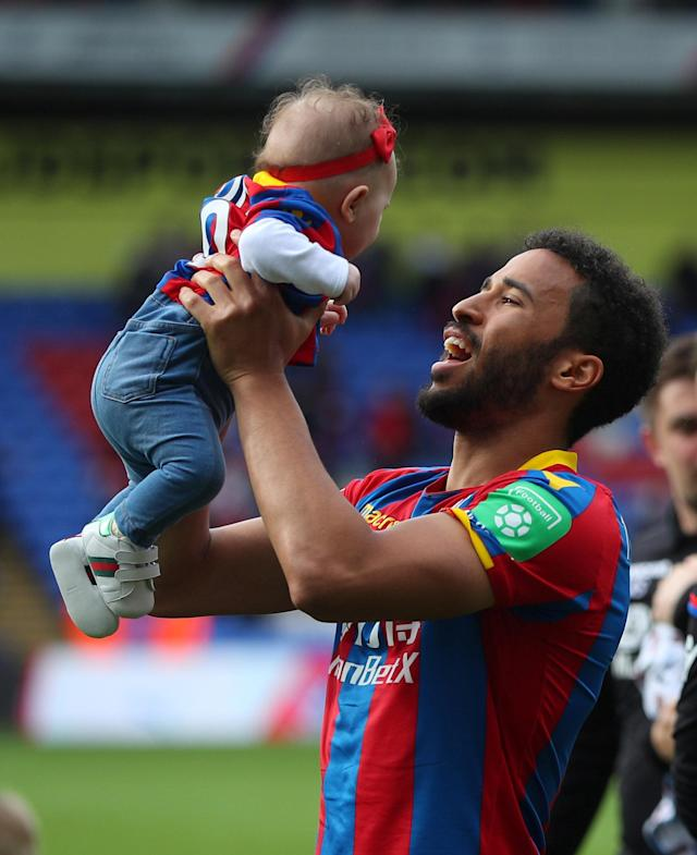 "Soccer Football - Premier League - Crystal Palace vs West Bromwich Albion - Selhurst Park, London, Britain - May 13, 2018 Crystal Palace's Andros Townsend with child after the match REUTERS/Hannah McKay EDITORIAL USE ONLY. No use with unauthorized audio, video, data, fixture lists, club/league logos or ""live"" services. Online in-match use limited to 75 images, no video emulation. No use in betting, games or single club/league/player publications. Please contact your account representative for further details."