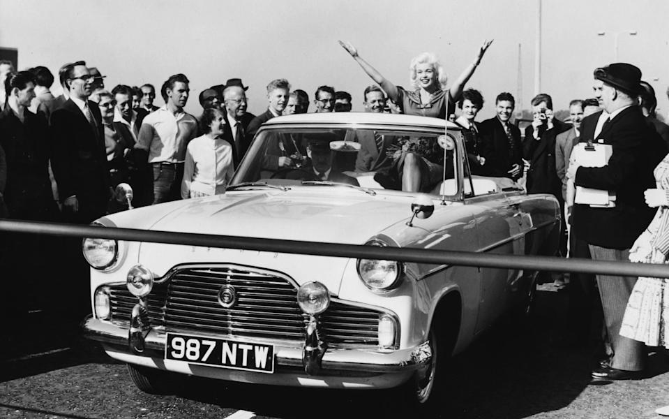 Hollywood star Jayne Mansfield brings an unlikely touch of glamour to west London's major road project in 1959 as she arrives in aFord Zephyr Mk2Convertible - Hulton Archive