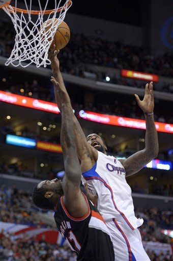 Los Angeles Clippers center DeAndre Jordan, right, puts up a shot as Portland Trail Blazers center J.J. Hickson defends during the first half of an NBA basketball game, Sunday, Jan. 27, 2013, in Los Angeles. (AP Photo/Mark J. Terrill)