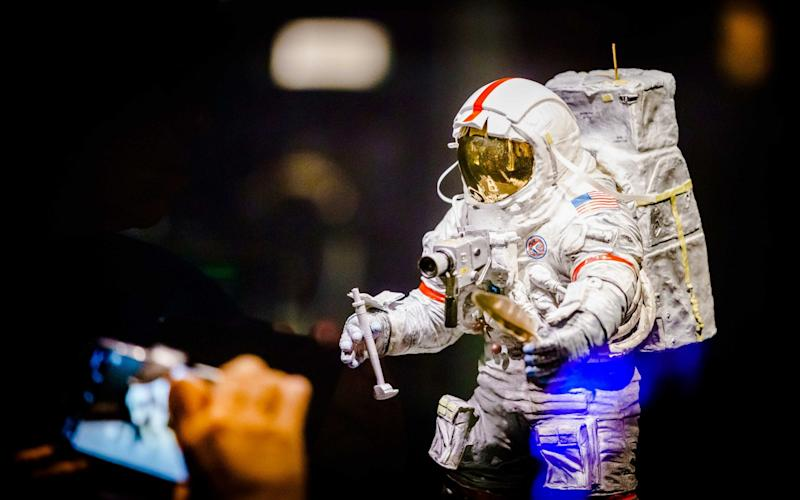 A model of an astronaut carrying a camera is displayed during the exhibition '50 Years of Moon landing' at the Space Expo in Noordwijk, The Netherlands - now the European Space Agency is launch a moon landing project - REX
