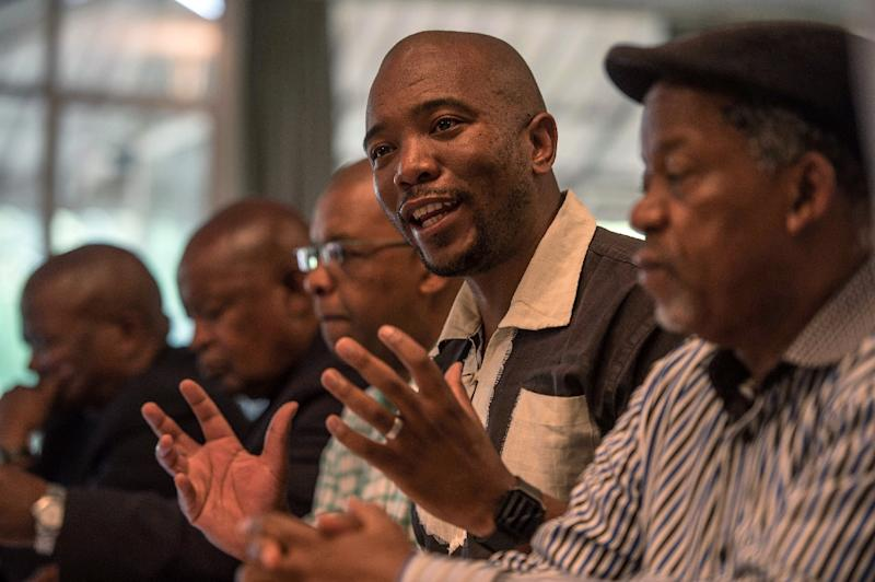 """Mmusi Maimane, leader of the main opposition Democratic Alliance, (2ndR) branded the S&P downgrade """"a clear vote of no confidence in President Zuma"""" (AFP Photo/MUJAHID SAFODIEN)"""