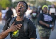 FILE - In this April 28, 2021 file photo, Dakwon Gibbs chants during a demonstration in Elizabeth City, N.C. The fatal shooting of a Black man by sheriff's deputies has sent shock waves through Elizabeth City. The majority Black city in the state's rural northeastern corner holds an important place in African American history in the 19th and 20th centuries. But some residents say it seemed too close-knit and too out-of-the-way to become a flashpoint in the 21st. (Robert Willett/The News & Observer via AP)