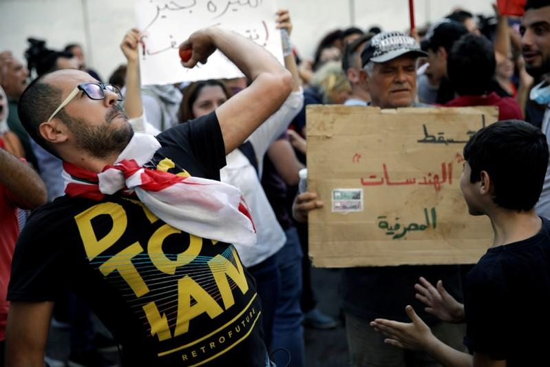 FILE PHOTO: A protester throws a tomato at Lebanon's central bank during a demonstration in Beirut
