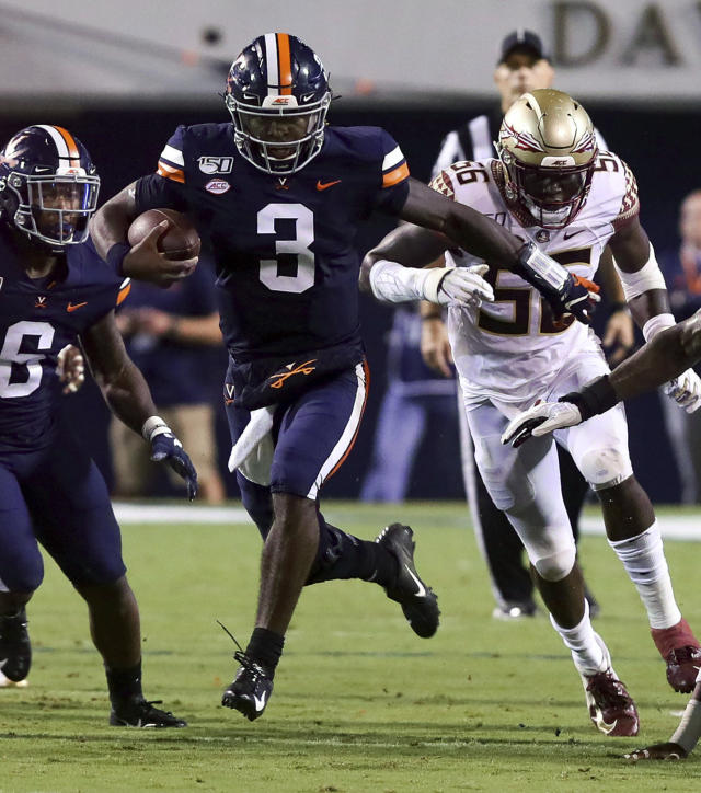 Virginia quarterback Bryce Perkins (3) runs the ball past Florida State linebacker Emmett Rice (56) during the first half of an NCAA college football game in Charlottesville, Va., Saturday, Sept. 14, 2019. (AP Photo/Andrew Shurtleff)