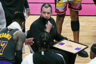 Los Angeles Lakers head coach Frank Vogel talks to guard Dennis Schroder (17) during a time out in the second half of an NBA basketball game against the Miami Heat, Thursday, April 8, 2021, in Miami. (AP Photo/Marta Lavandier)