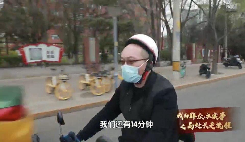 Wang Lin, deputy director of the labour relations division at the Beijing Municipal Human Resources and Social Security Bureau, is shown spending a day at work as a Meituan delivery driver in Beijing on April 28, 2021. Photo: Handout