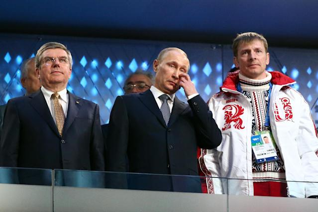 SOCHI, RUSSIA - FEBRUARY 23: (L-R) International Olympic Committee (IOC) President Thomas Bach, President of Russia Vladimir Putin and double bobsleigh gold medalist Alexander Zubkov of Russia look on during the 2014 Sochi Winter Olympics Closing Ceremony at Fisht Olympic Stadium on February 23, 2014 in Sochi, Russia. (Photo by Ryan Pierse/Getty Images)