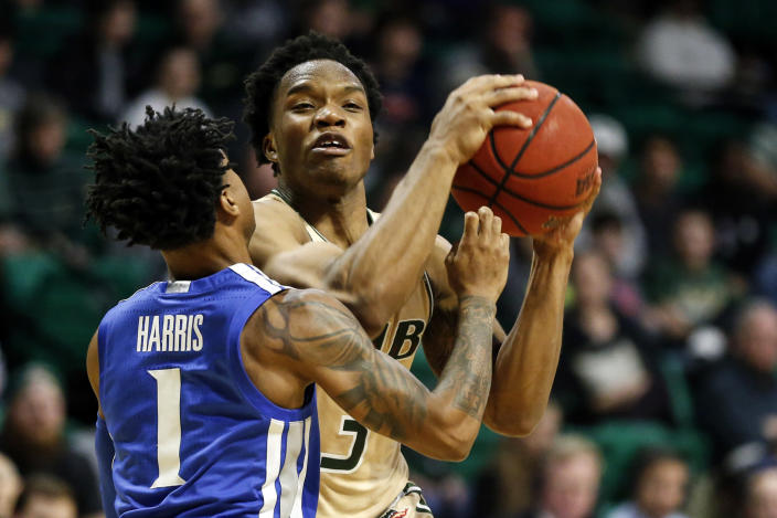 UAB guard Tavin Lovan (3) drives to the basket as Memphis guard Tyler Harris (1) defends during the second half of an NCAA college basketball game Saturday, Dec. 7, 2019, in Birmingham, Ala. (AP Photo/Butch Dill)