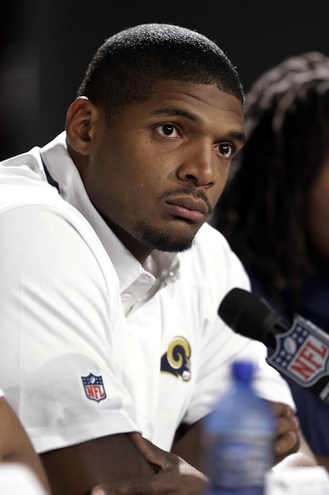 FILE - In this May 13, 2014 file photo, St. Louis Rams seventh-round draft pick Michael Sam listens to a question during a news conference at the NFL football team's practice facility in St. Louis. When Sam was drafted by the St. Louis Rams on May 10, 2014, he became the first openly gay player ever drafted by an NFL team. It is a milestone has made longtime gay fans all the more enthusiastic, and already is drawing newcomers into the fold. (AP Photo/Jeff Roberson, File)