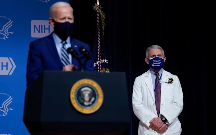 President Joe Biden speaks during a visit to the Viral Pathogenesis Laboratory at the National Institutes of Health in Bethesda MD - AP