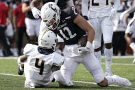 Cincinnati wide receiver Alec Pierce (12) reacts after being tackled by Murray State cornerback Quinaz Turner (4) during the first half of an NCAA college football game Saturday, Sept. 11, 2021, in Cincinnati. (AP Photo/Jeff Dean)