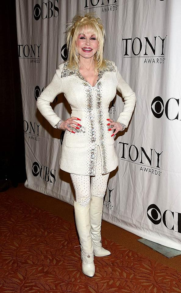 "Where to begin? The ""hair""? The eye shadow? The sea shell-adorned ensemble? How 'bout the nails? Don't get me wrong; I love me some Dolly Parton, but girlfriend needs a makeover ASAP. Jason Kempin/<a href=""http://www.wireimage.com"" target=""new"">WireImage.com</a> - May 6, 2009"
