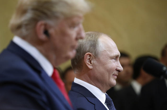 <p>Russian President Vladimir Putin smiles during a press conference with U.S. President Donald Trump after the meeting of U.S. President Donald Trump and Russian President Vladimir Putin at the Presidential Palace in Helsinki, Finland, July 16, 2018. (Photo: Alexander Zemlianichenko/AP) </p>