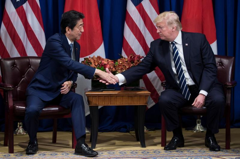 Shinzo Abe, Japan's prime minister, and U.S. President Donald Trump talked during the United Nations General Assembly in New York City in September. They will see each other again during Trump's trip to Asia. (Brendan Smialowski/AFP/Getty Images)