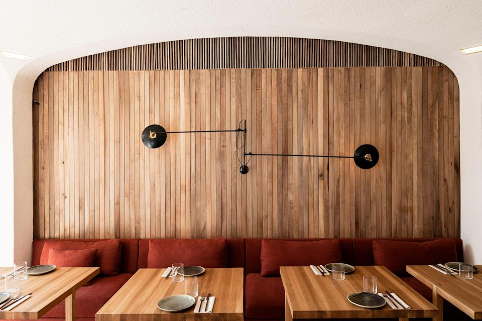 """<p><strong>Tell us about your first impressions when you arrived.</strong><br> Oak paneling, soft fabrics, and a lush interior garden places the Green Spot right on trend as a hip, new vegetarian restaurant targeting discerning clean eaters.</p> <p><strong>What was the crowd like?</strong><br> A young, fashionable crowd of veggie-centric diners looking for a healthy, delicious meal. Expect plenty of beards and tattoos.</p> <p><strong>What should we be drinking?</strong><br> Wines by the glass are limited here, but there are some solid bottles: go for the Priorat Ceps Nous (red) or the Mar de Ons Albariño (white) if you're stuck. Beer drinkers will be happy, too, with plenty of artisanal options on tap. If it's your dry month, try one of the cold-pressed juices for a different kind of buzz.</p> <p><strong>Main event: the food. Give us the lowdown—especially what not to miss.</strong><br> Billed as the vegetarian restaurant that is """"veggie for non-veggies,"""" the Green Spot does indeed manage to please vegetarians and carnivores alike. The varied selection showcases tasty curries, chilis, and pizzas, but also lighter, healthier things like grilled-vegetable salads. Personal favorites include the fried cauliflower with mint and tamarind sauce, the four-cheese pizza with zucchini flowers and Jerusalem artichokes, and the Moroccan tagine with bulgur wheat.</p> <p><strong>And how did the front-of-house folks treat you?</strong><br> Young, hip, and enthusiastic, just like the restaurant.</p> <p><strong>What's the real-real on why we're coming here?</strong><br> If you've tucked into a few too many plates of <a href=""""https://www.cntraveler.com/gallery/best-tapas-bars-in-barcelona?mbid=synd_yahoo_rss"""" rel=""""nofollow noopener"""" target=""""_blank"""" data-ylk=""""slk:fried croquettes and calamari"""" class=""""link rapid-noclick-resp"""">fried croquettes and calamari</a> while in Barcelona, the Green Spot is the place to take a breather.</p>"""