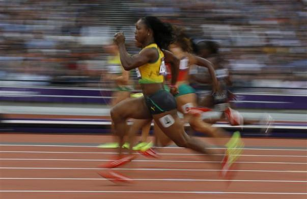 Jamaica's Veronica Campbell-Brown takes the lead in her women's 100m round 1 event at the London 2012 Olympic Games in the Olympic Stadium August 3, 2012.