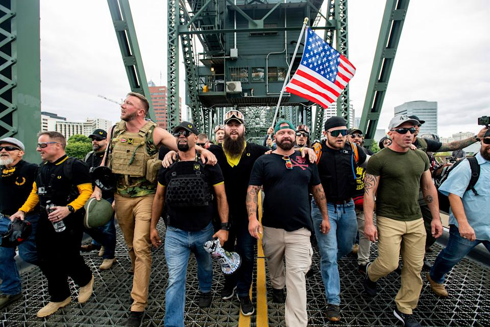 Proud Boys and other fascists march across the Hawthorne Bridge on Saturday. (Photo: ASSOCIATED PRESS)