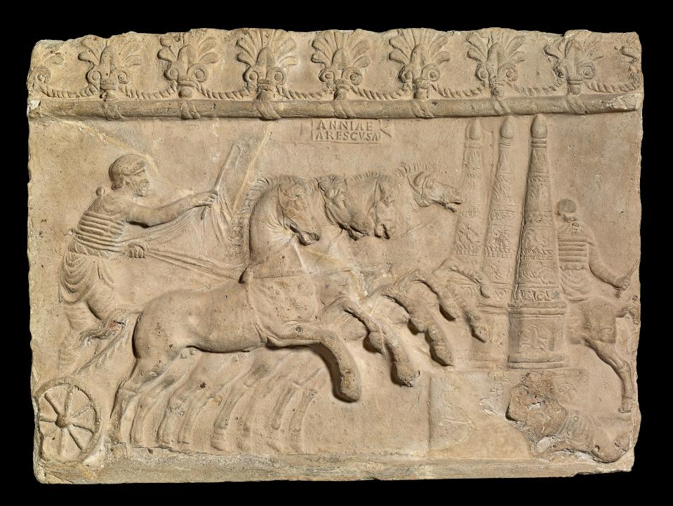 Terracotta relief showing a chariot-race, Italy, AD 40–70 (The Trustees of the British Museum/PA)