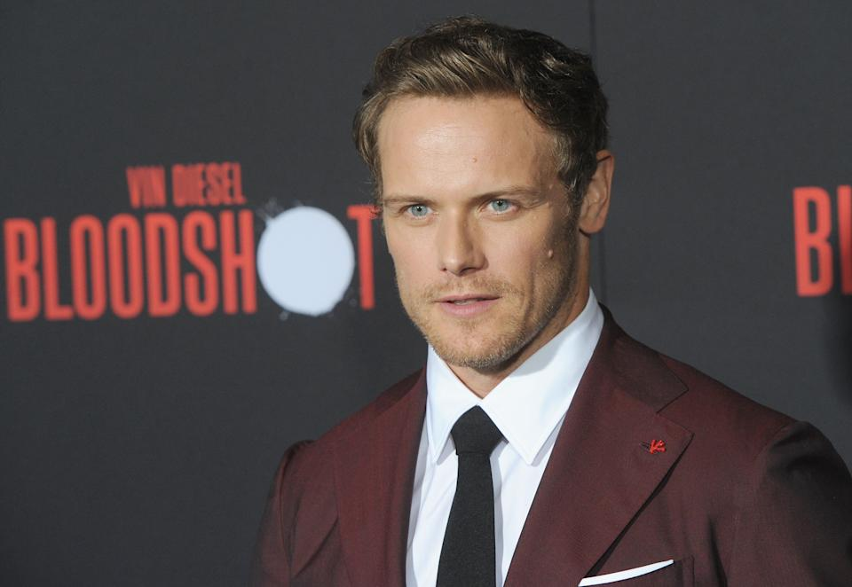 """Sam Heughan arrives for the premiere of Sony Pictures' """"Bloodshot"""" on March 10, 2020. (Photo by Albert L. Ortega/Getty Images)"""