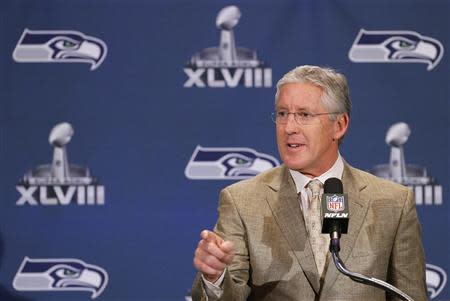 Seattle Seahawks head coach Carroll speaks during news conference after team's arrival for Super Bowl XLVIII against Denver Broncos in Jersey City
