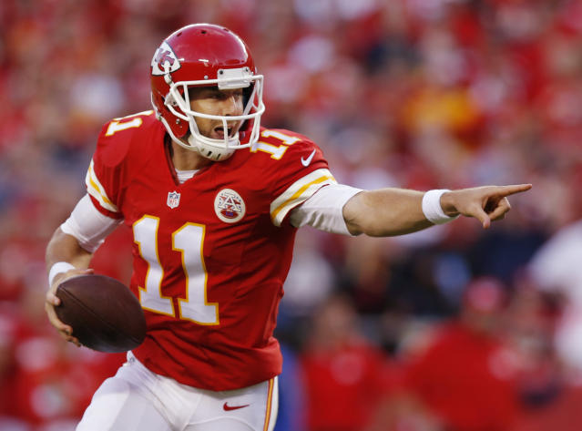 Kansas City Chiefs quarterback Alex Smith (11) directs his receivers during the second half of an NFL football game against the Houston Texans at Arrowhead Stadium in Kansas City, Mo., Sunday, Oct. 20, 2013. (AP Photo/Ed Zurga)
