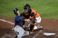 Tampa Bay Rays' Joey Wendle, left, is tagged out at home by Baltimore Orioles catcher Chance Sisco during the fourth inning of a baseball game Saturday, Sept. 19, 2020, in Baltimore. (AP Photo/Nick Wass)