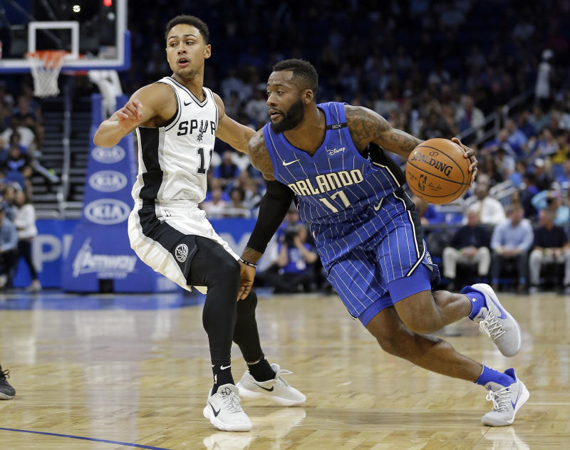 Orlando Magic's Jonathon Simmons (17) drives around San Antonio Spurs' Bryn Forbes, left, during the first half of an NBA basketball game, Friday, Oct. 27, 2017, in Orlando, Fla. (AP Photo/John Raoux)