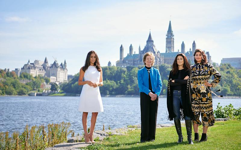 Meghan Markle poses with former President of Ireland Mary Robinson, poet Fatima Bhutto, and women's rights activist Loujain al-Hathloul