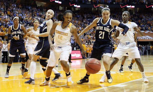 Tennessee forward Bashaara Graves (12) battles Notre Dame guard Kayla McBride (21) for the ball in the first half of an NCAA college basketball game Monday, Jan. 20, 2014, in Knoxville, Tenn. (AP Photo/Wade Payne)