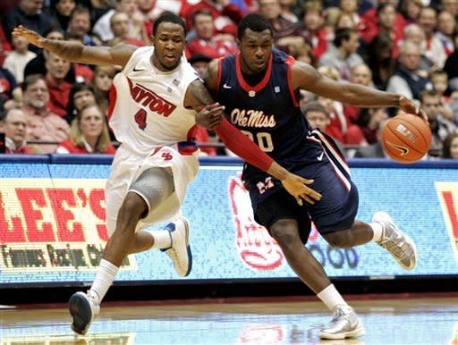 Dayton's Chris Johnson (4) tries to steal the ball from Mississippi's Nick Williams (20) during the first half of an NCAA college basketball game, Friday, Dec. 30, 2011, in Dayton, Ohio. (AP Photo/Skip Peterson)