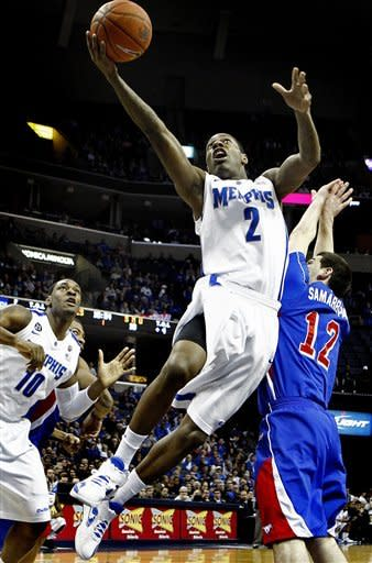 Memphis' Antonio Barton (2) drives to the basket around SMU's Jeremiah Samarrippas (12) as teammate Tarik Black (10) looks on during first half action in an NCAA college basketball game at the FedExForum, Saturday, jan. 21, 2012, in Memphis. (AP Photo/The Commercial Appeal, Mark Weber)