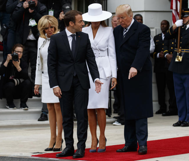 <p>From right, President Donald Trump, first lady Melania Trump, French President Emmanuel Macron and his wife Brigitte Macron, take their positions for a photograph during a State Arrival Ceremony on the South Lawn of the White House in Washington, Tuesday, April 24, 2018. (Photo: Carolyn Kaster/AP) </p>
