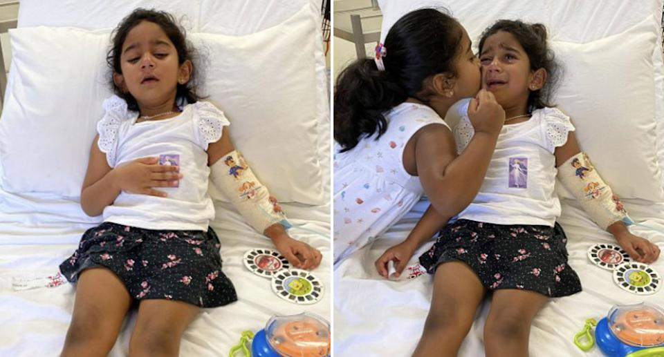 Tharnicaa Murugappan, 3, pictured with her sister Kopika in a hospital bed.