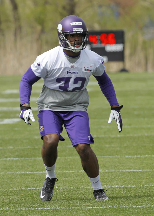Defensive back Antone Exum takes part in a drill during the Minnesota Vikings' NFL football minicamp in Eden Prairie, Minn., Friday, May 16, 2014. New Vikings coach Mike Zimmer set to work getting young players like quarterback Teddy Bridgewater, linebacker Anthony Barr and defensive backs Exum and Kendall James up to speed on what will be expected of them in the NFL. (AP Photo/Ann Heisenfelt)
