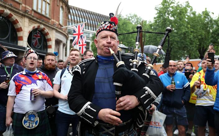 A bagpipe player as Scotland fans gather in Leicester Square before the UEFA Euro 2020 match - Kieran Cleeves/PA Wire