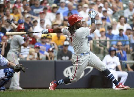 Jun 17, 2018; Milwaukee, WI, USA; Philadelphia Phillies third baseman Maikel Franco (7) hits a single to drive in 2 runs in the seventh inning against the Milwaukee Brewers at Miller Park. Mandatory Credit: Benny Sieu-USA TODAY Sports
