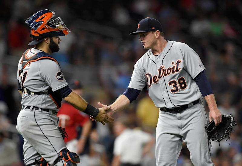 Alex Avila #31 and Justin Wilson #38 of the Detroit Tigers celebrate winning the game against the Minnesota Twins on July 21, 2017 at Target Field in Minneapolis, Minnesota. The Tigers defeated the Twins 6-3.
