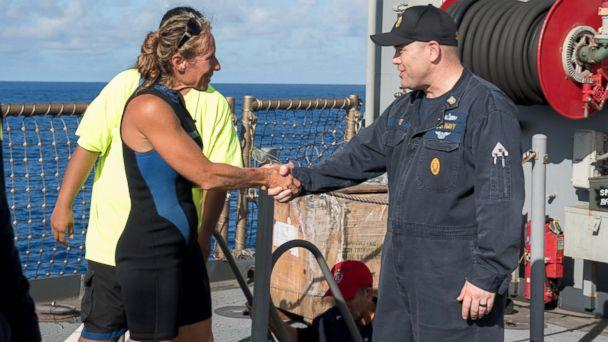 PHOTO: USS Ashland (LSD 48) Command Master Chief Gary Wise welcomes aboard Jennifer Appel, an American mariner who had received assistance from Ashland crew members, Oct. 25, 2017. (Mass Communication Specialist 3rd Class Jonathan Clay/Navy)