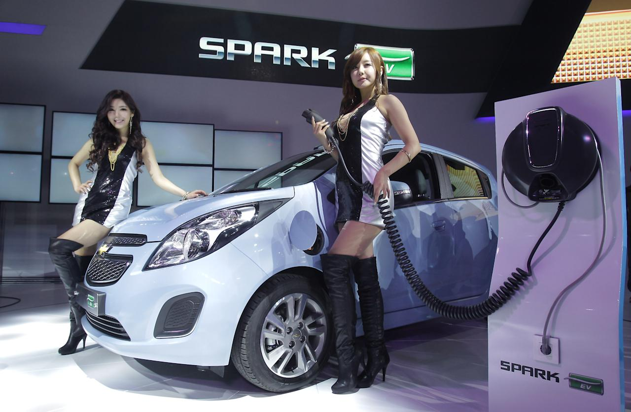 GOYANG, SOUTH KOREA - MARCH 28:  Models pose next to a Chevrolet Spark EV at the Seoul Motor Show 2013 on March 28, 2013 in Goyang, South Korea. The Seoul Motor Show 2013 will be held in March 29-April 7, featuring state-of-the-art technologies and concept cars from global automakers. The show is its ninth since the first one was held in 1995. About 384 companies from 14 countries, including auto parts manufacturers and tire makers, will set up booths to showcase trends in their respective industries, and to promote their latest products during the show.  (Photo by Chung Sung-Jun/Getty Images)