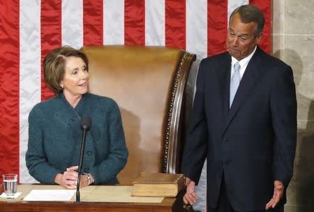 Pelosi makes remarks before handing the gavel to House Speaker John Boehner after he was re-elected speaker on the House floor at the U.S. Capitol in Washington