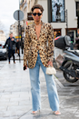 <p>Straight out of the gates we have this snazzy animal print blazer neatly offsetting the slouchy jeans. Finish with angular shades, chunky hardware and strappy heels for extra pizzazz.</p>