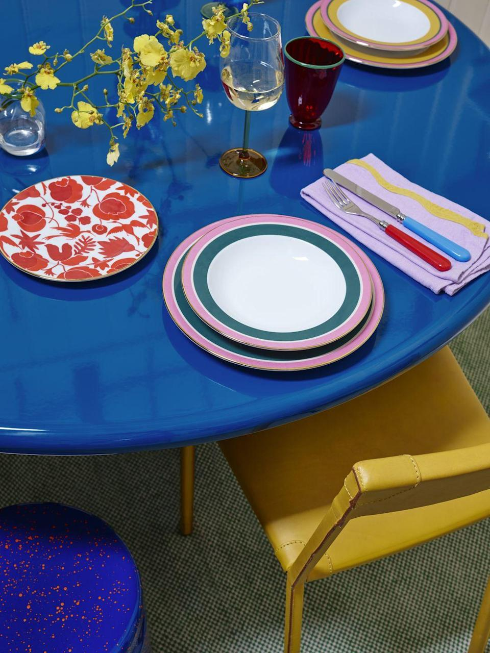 """<p>Getting the colour balance right for this look is essential, so pick contemporary variations of block primary hues as your base. Here, we've combined furniture pieces in cherry red, azure blue and bumblebee yellow to set the scene, with touches of lilac and fern green to add depth. It's important to keep patterns to a minimum for a sophisticated effect – simply allow these bold hues to sing out against neutral white walls. 'Smalto' table by Barber & Osgerby for Knoll, £4,176, <a href=""""https://www.scp.co.uk/products/smalto-table-round"""" rel=""""nofollow noopener"""" target=""""_blank"""" data-ylk=""""slk:scp.com"""" class=""""link rapid-noclick-resp"""">scp.com</a>; La DoubleJ 'Rainbow' plate and bowl, £80, <a href=""""https://www.matchesfashion.com/products/La-DoubleJ-Rainbow-18kt-gilded-porcelain-bowl-%26-plate-set-1406948"""" rel=""""nofollow noopener"""" target=""""_blank"""" data-ylk=""""slk:matchesfashion.com"""" class=""""link rapid-noclick-resp"""">matchesfashion.com</a>; set of six linen napkins, £92, and 12 piece 'Rainbow' cutlery set, £130, both <a href=""""https://matildagoad.com/"""" rel=""""nofollow noopener"""" target=""""_blank"""" data-ylk=""""slk:matildagoad.com"""" class=""""link rapid-noclick-resp"""">matildagoad.com</a><br><br></p>"""