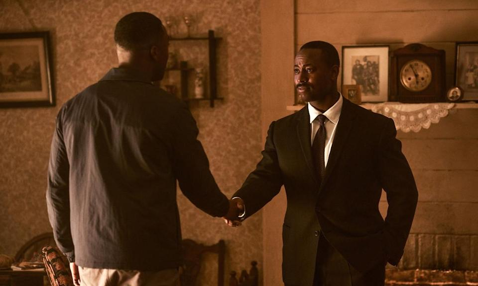 photo of Doctor Who companion Ryan Sinclair shaking the hand of Dr. Martin Luther King, Jr.