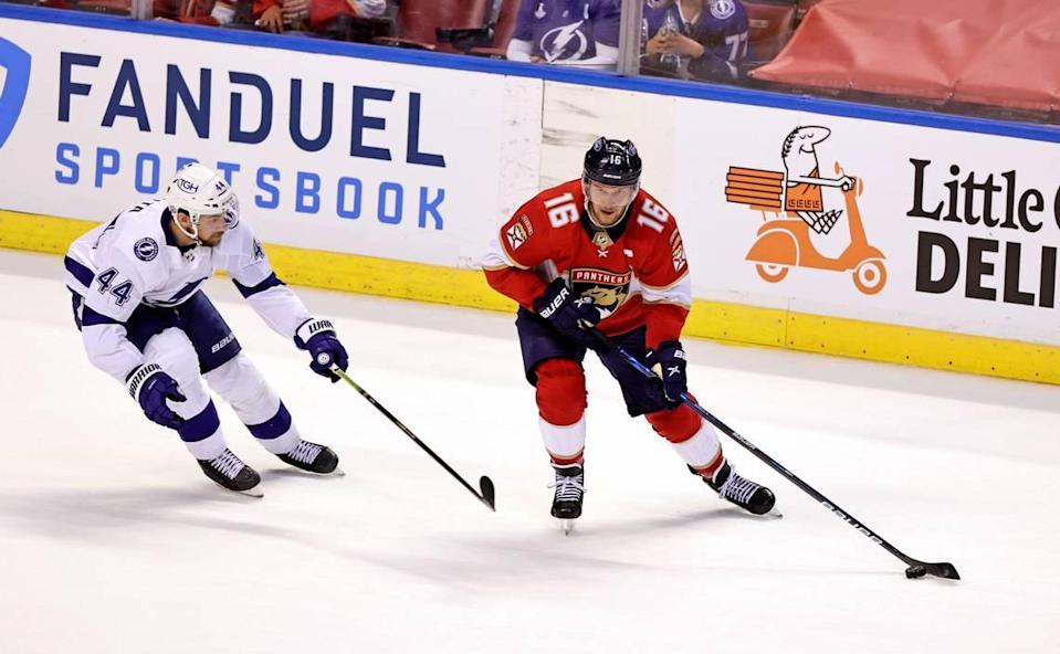 Florida Panthers center Aleksander Barkov (16) carries the puck against Tampa Bay Lightning defenseman Jan Rutta (44) during the first period of game 1 of their first round NHL Stanley Cup series at the BB&T Center on Sunday, May 16, 2021 in Sunrise, Fl.