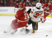 Carolina Hurricanes' Alexander Semin (28), of Russia, and Calgary Flames' Devin Setoguchi (22) collide during the second period of an NHL hockey game in Raleigh, N.C., Monday, Nov. 10, 2014. (AP Photo/Gerry Broome)