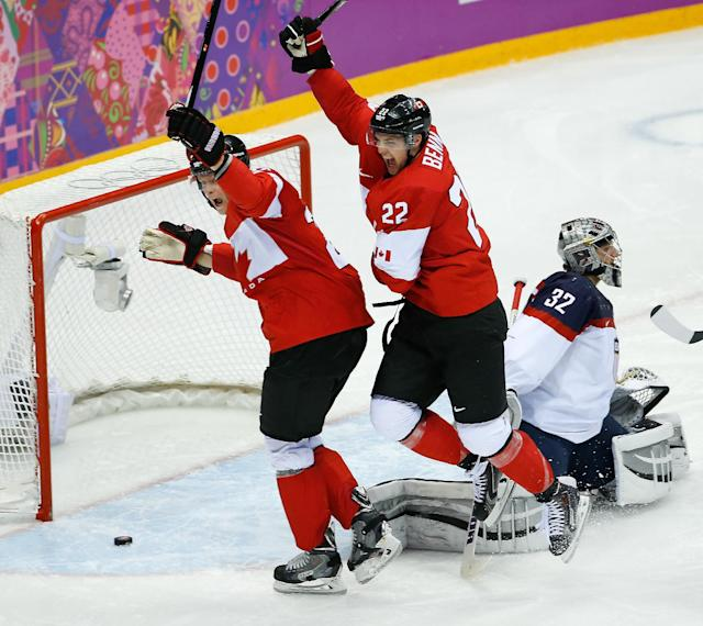 Canada forward Benn Jamie (22) celebrates his goal against USA goaltender Jonathan Quick (32) during the second period of the men's semifinal ice hockey game at the 2014 Winter Olympics, Friday, Feb. 21, 2014, in Sochi, Russia. (AP Photo/Matt Slocum)