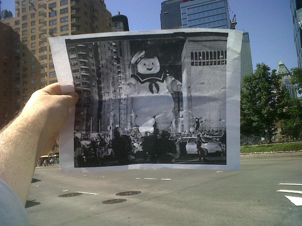 """Ghostbusters (1984): Moloney, who lives in New York City, started the project in June. """"I noticed I had roughly the same commute as the Stay Puft Marshmallow Man.  I printed off the scene and snapped the photo.  I posted it on Facebook and my friends really liked it.  So, I started taking more shots.  Eventually, I started my Tumblr FILMography,"""" he said."""
