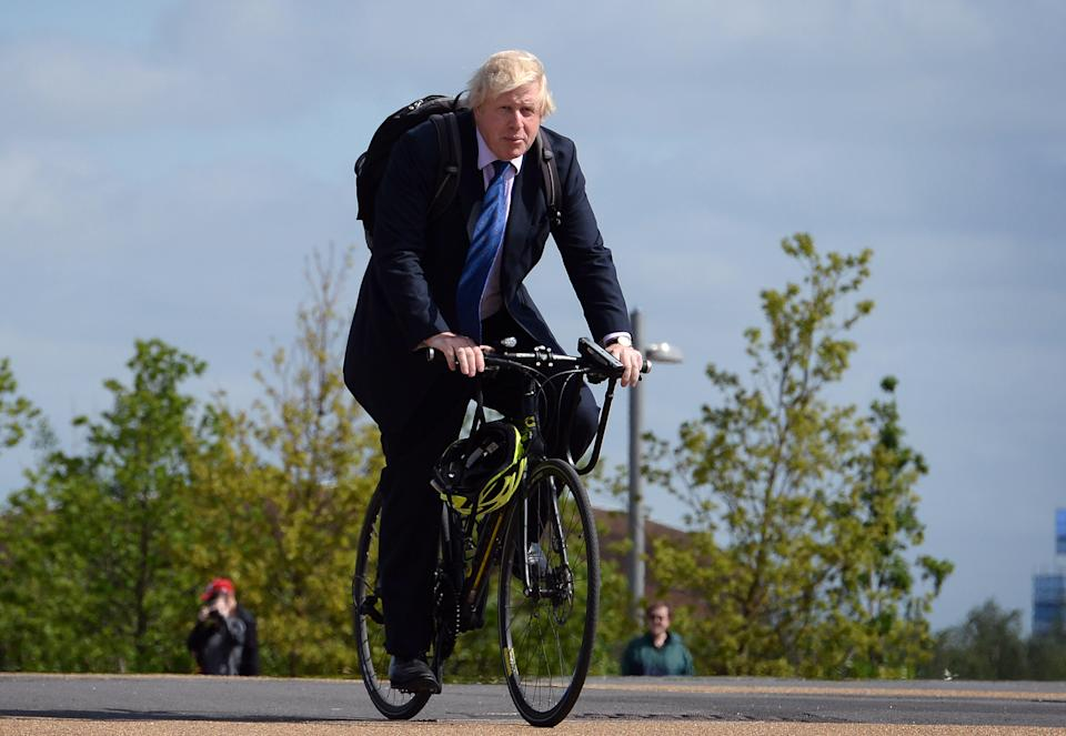 Boris Johnson cycling around the Olympic Park in 2015, when he was mayor of London. He was spotted cycling around the park on Sunday, raising questions about compliance with coronavirus rules. (Stefan Rousseau/PA)