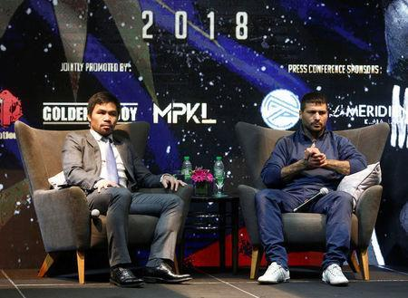 "Philippine boxing icon Manny ""Pacman"" Pacquiao and welterweight world title holder Lucas Matthysse attend a news conference for their upcoming WBA ""regular"" welterweight title fight, at a hotel in Kuala Lumpur, Malaysia April 20, 2018. REUTERS/Lai Seng Sin"